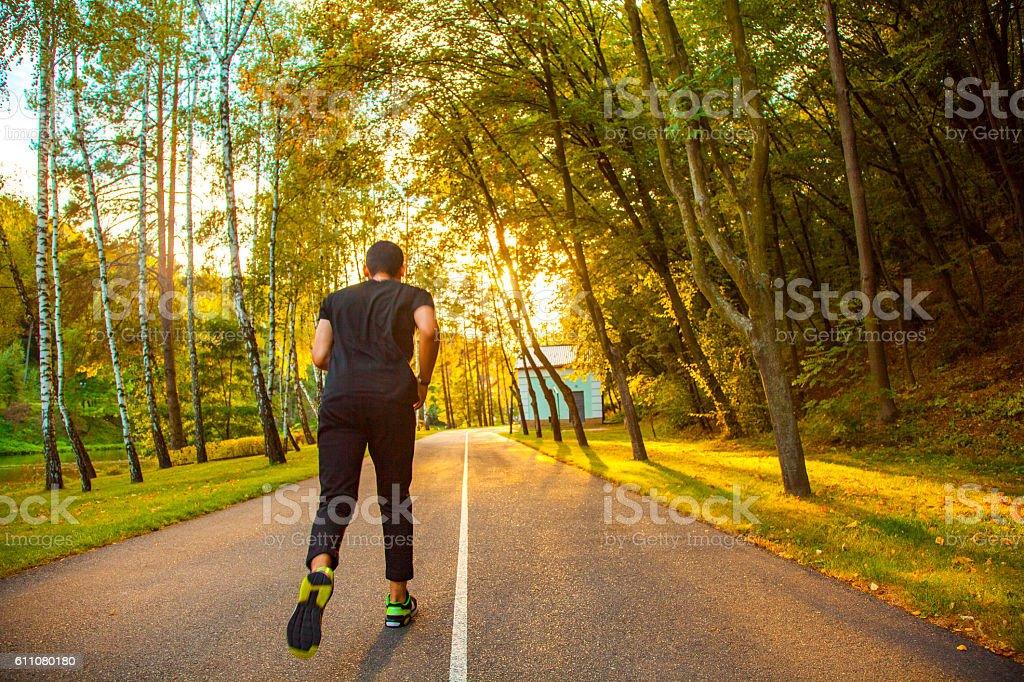 man fitness sunrise jogging workout wellness concept. stock photo