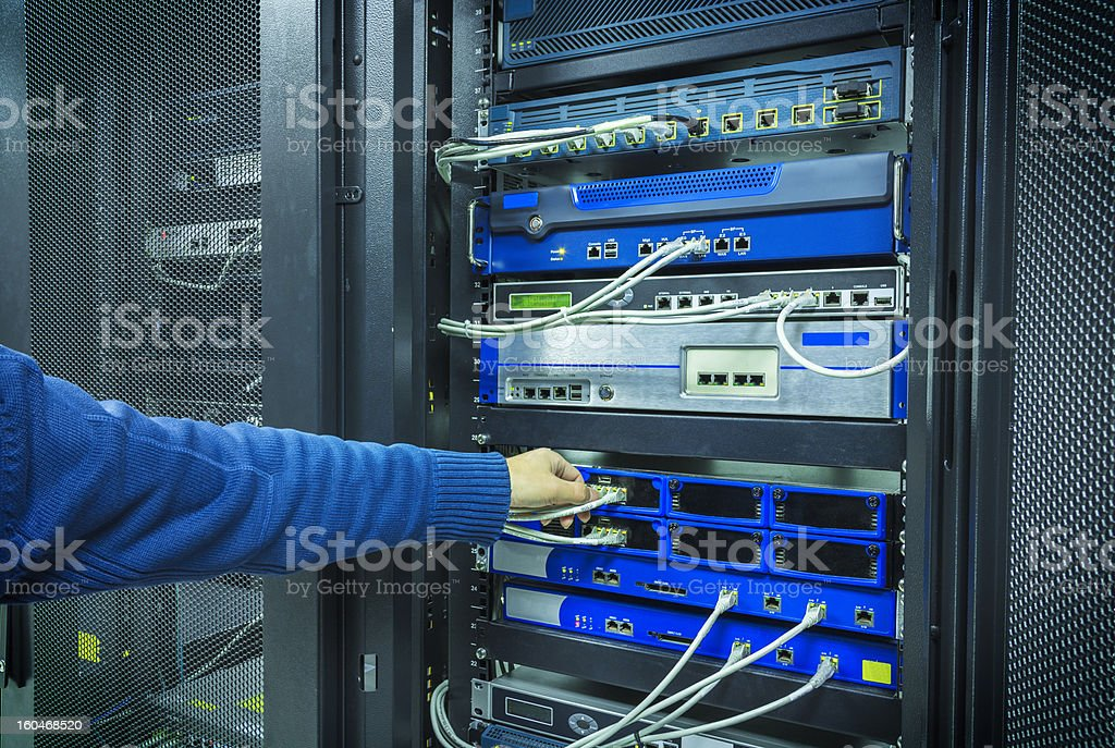 A man fixing a network patchwork royalty-free stock photo