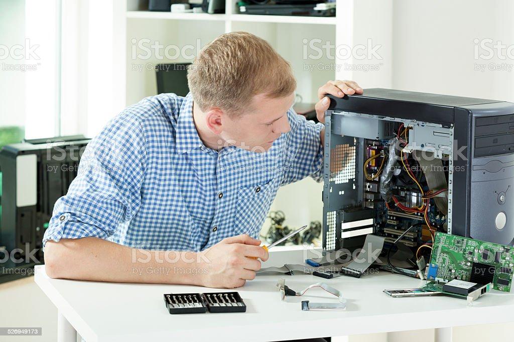 Man fixing computer stock photo