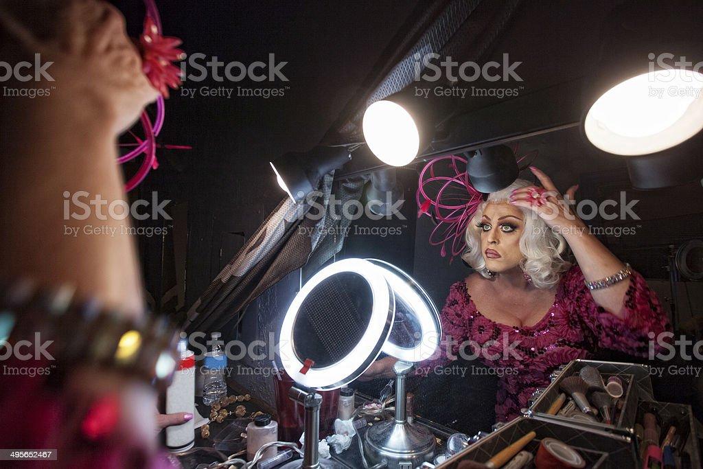 Man Fixing Hair in Mirror stock photo