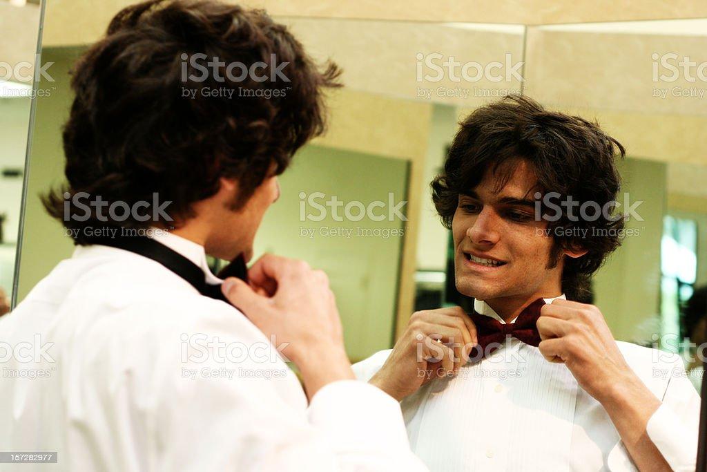 Man Fixing his Bow Tie royalty-free stock photo
