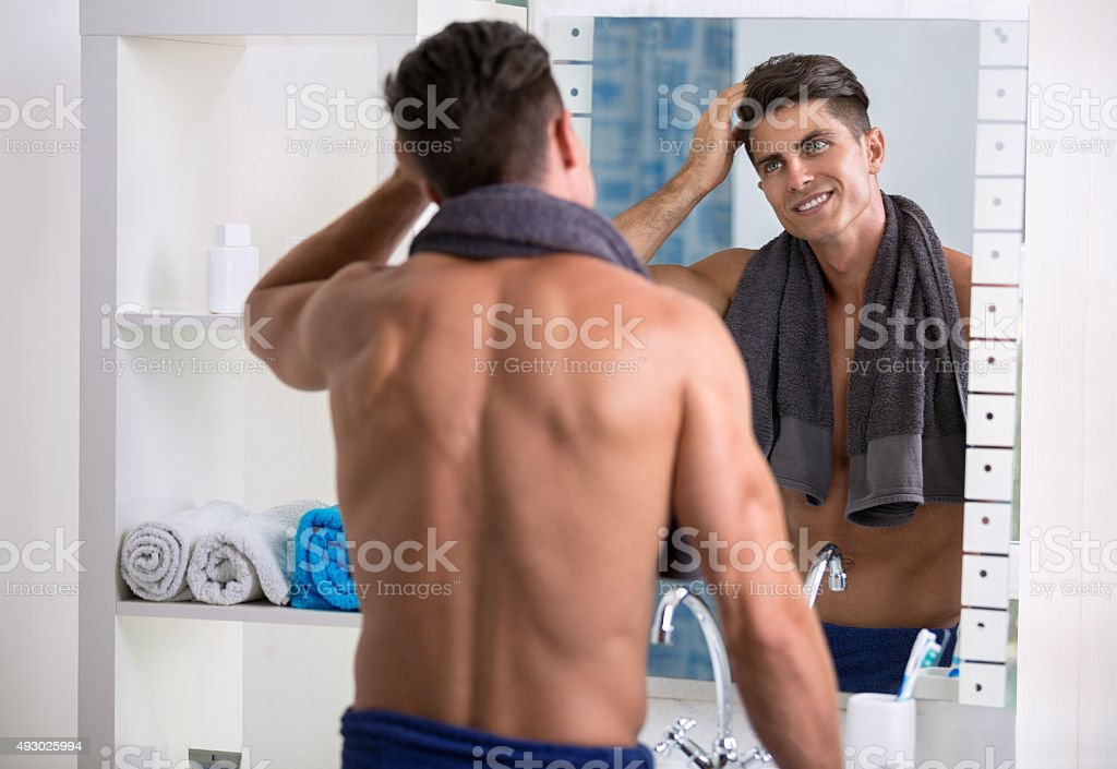 Man fixing his hair stock photo