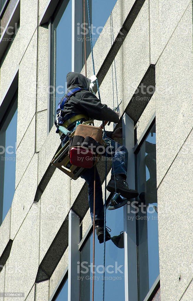 Man fixing windows on rope royalty-free stock photo
