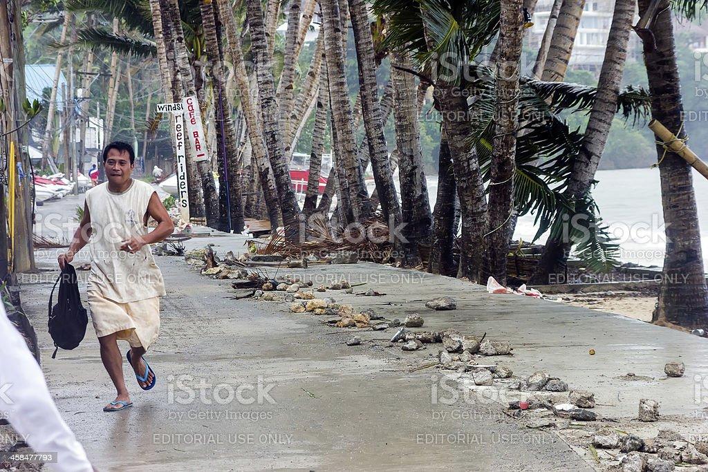 Man fleeing Typhoon Haiyan royalty-free stock photo