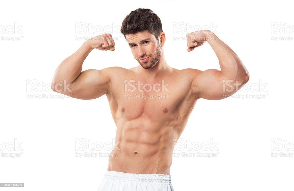 Man Flexing Muscles stock photo