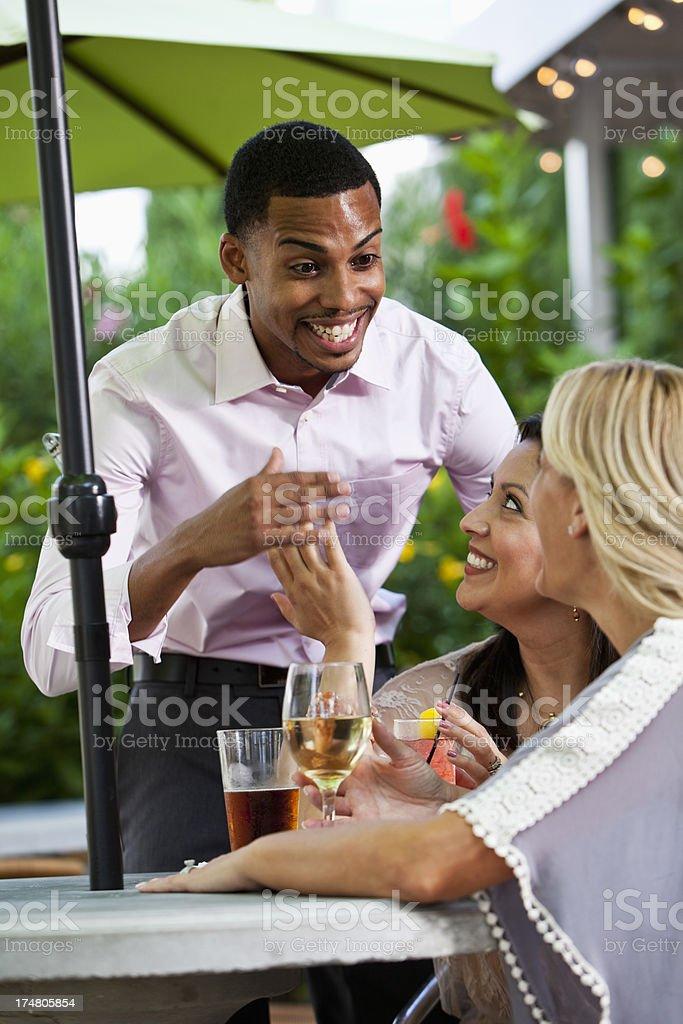 Man flirting with women stock photo