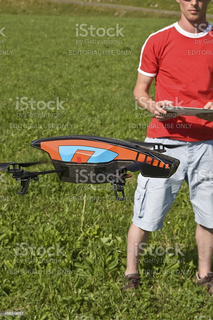 Man flying a drone with its touch pad royalty-free stock photo