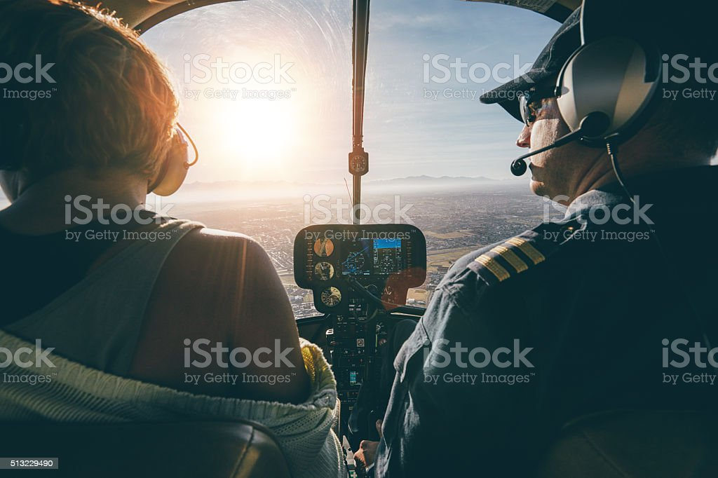 Man flying a helicopter with his copilot stock photo