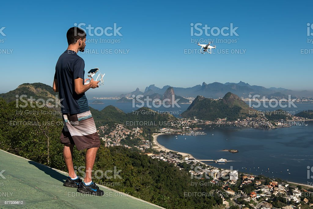 Man Flying with a Drone stock photo