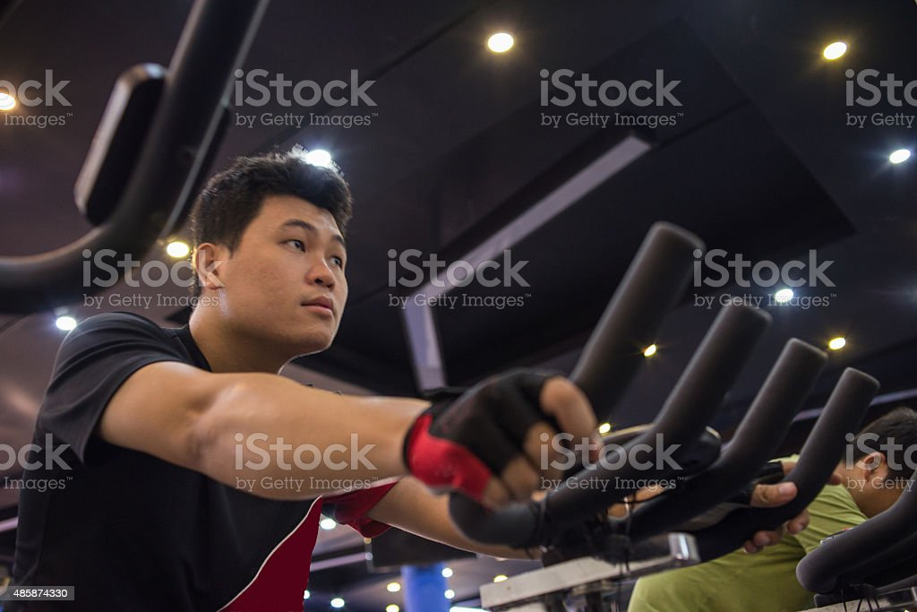Man focus on doing exercise in the gym stock photo