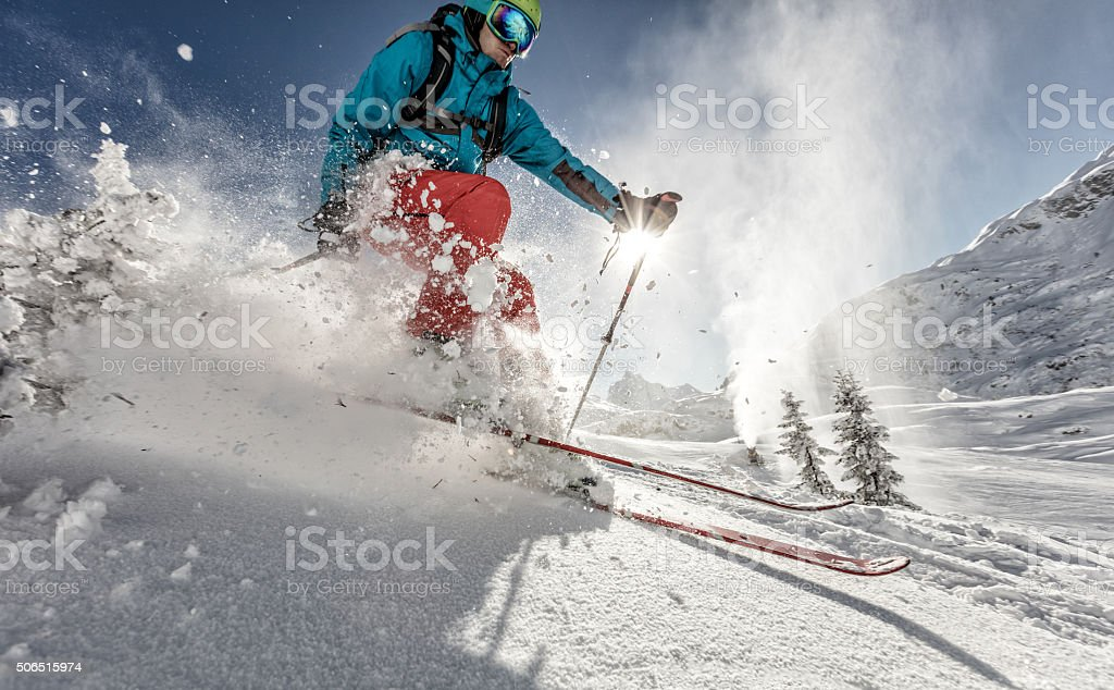Man freerideer running downhill stock photo