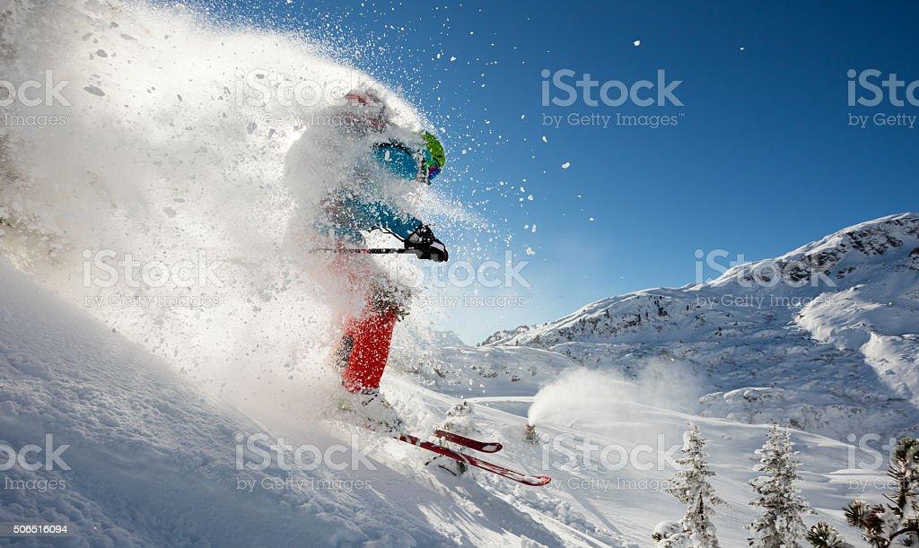Man freerideer running downhill stock photo