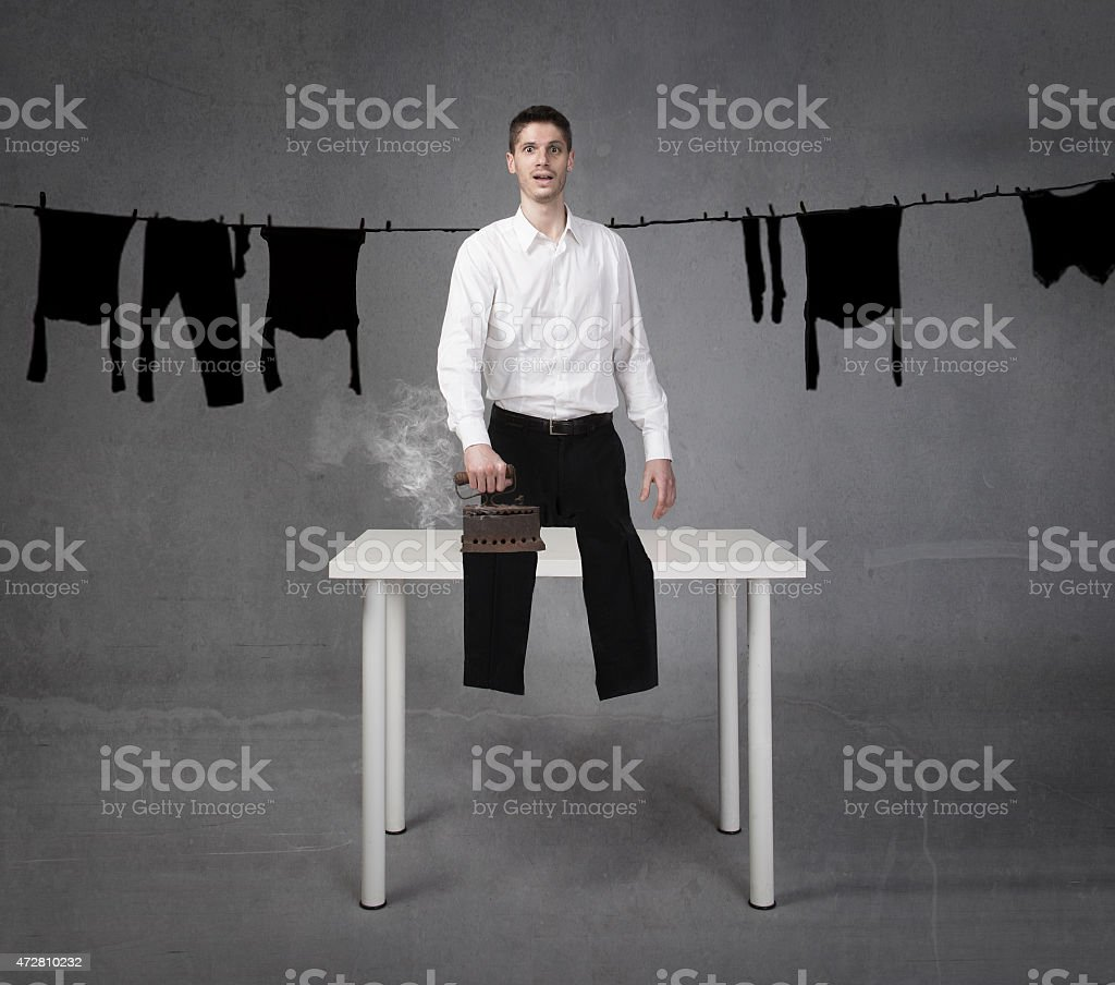 man funny ironing clothes stock photo