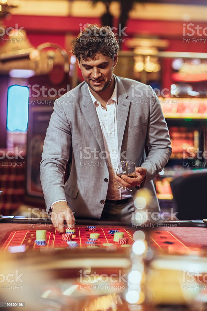 Man   gambling at roulette in casino stock photo