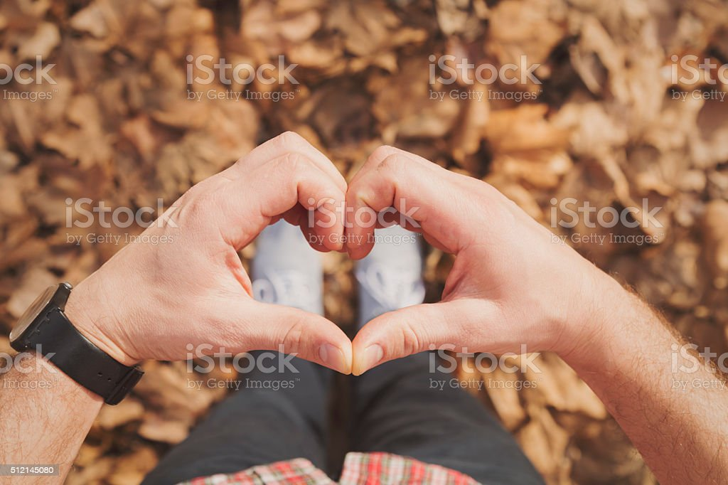 Man gesturing heart shaped hands. stock photo