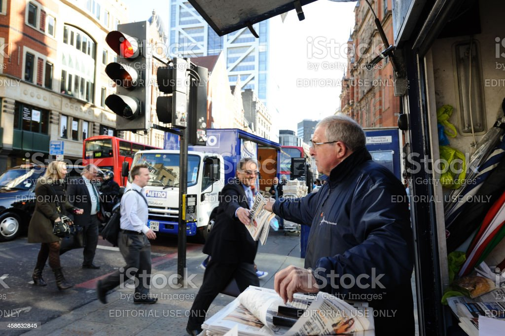 Man gets a free newspaper in London stock photo