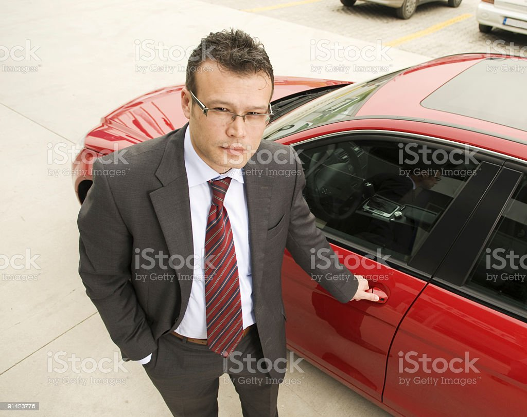 Man gets into his red car royalty-free stock photo