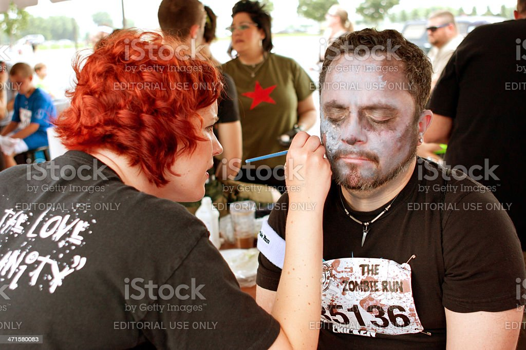Man Gets Zombie Makeover From Makeup Artist stock photo