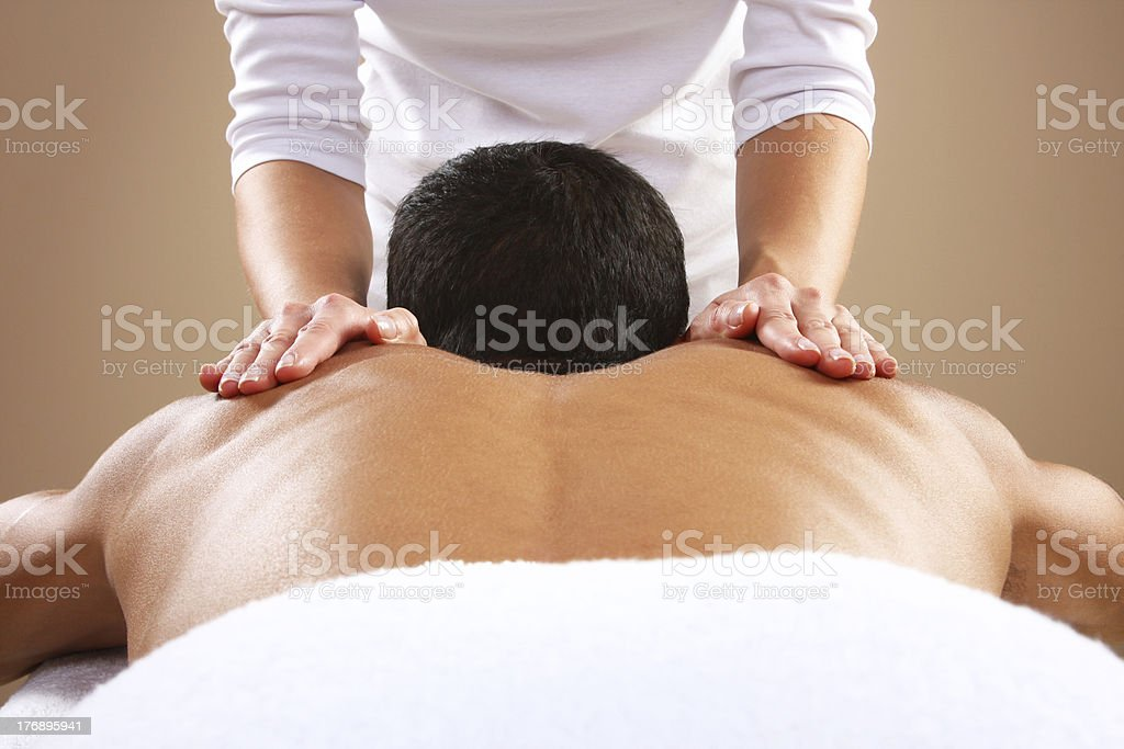 Man getting a back massage. stock photo
