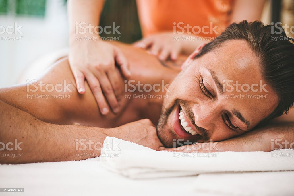 Man getting a massage at the healthspa stock photo