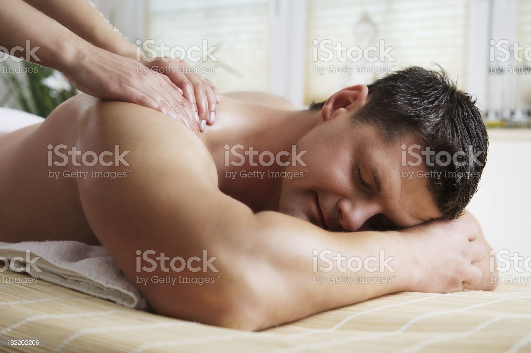 Man getting a massage royalty-free stock photo