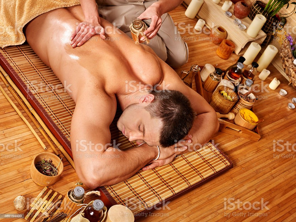 Man getting aroma massage in spa stock photo