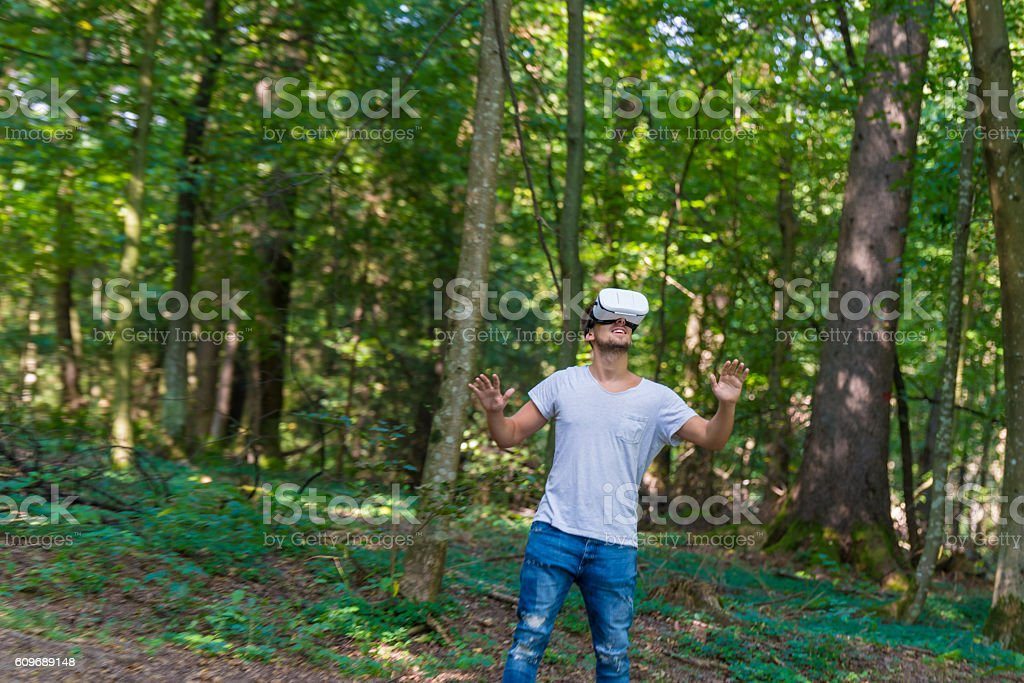 Man getting experience using VR-headset glasses of virtual reality stock photo