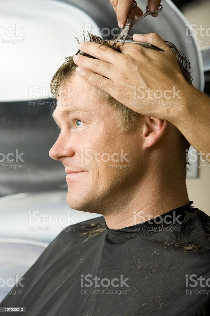 Man Getting Haircut at Salon stock photo