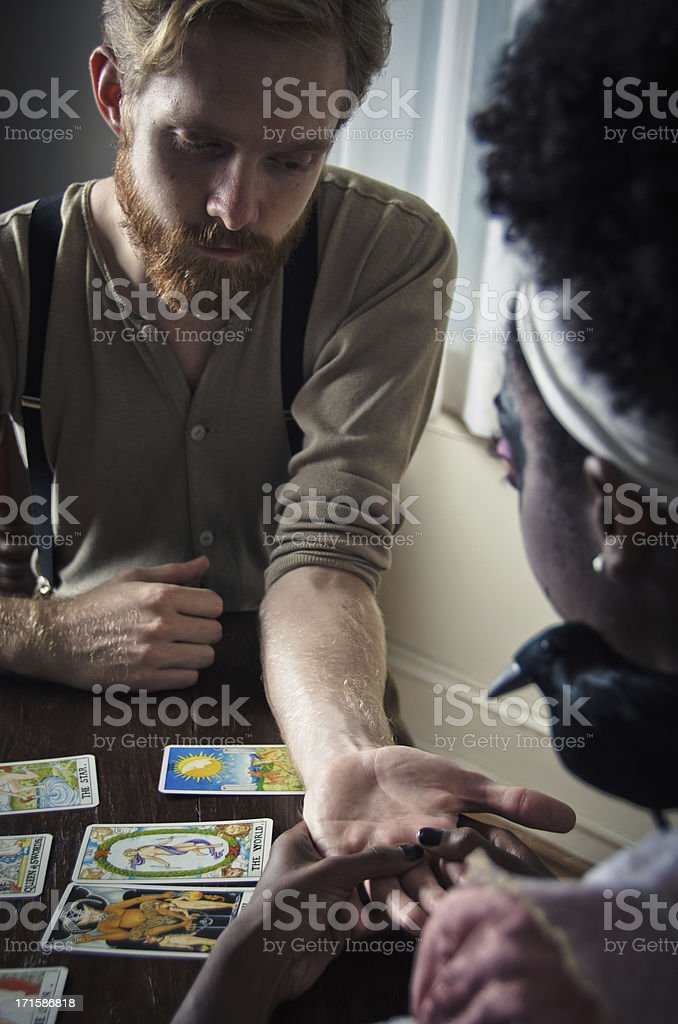 Man Getting His Future Told By Palm Reading stock photo
