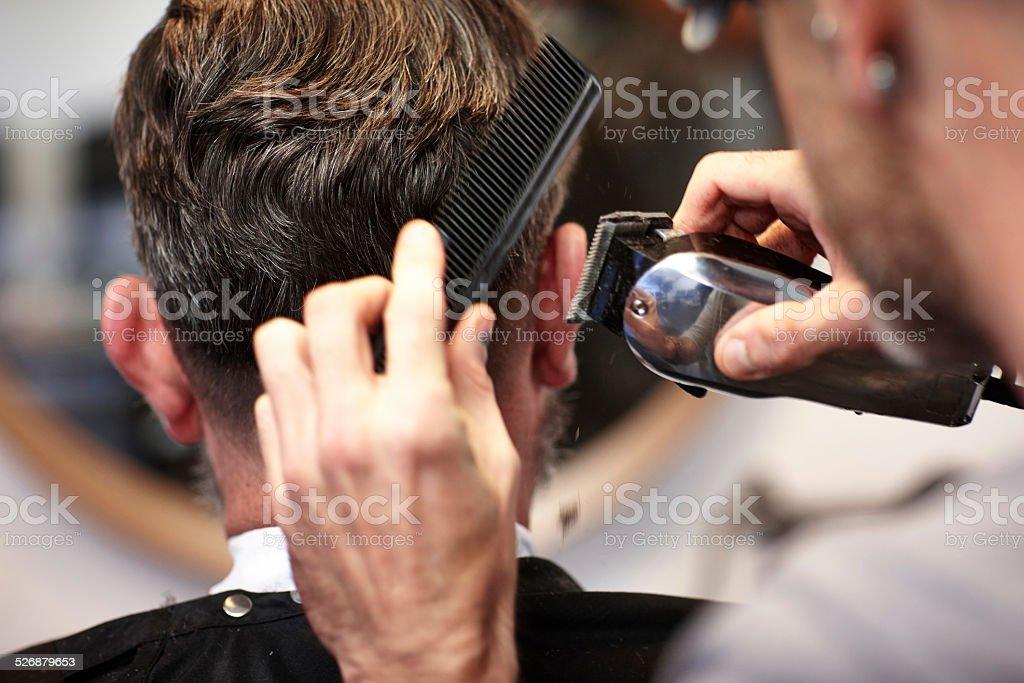 Man getting his hair cut at salon stock photo