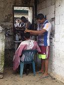Man getting his haircut outdoors
