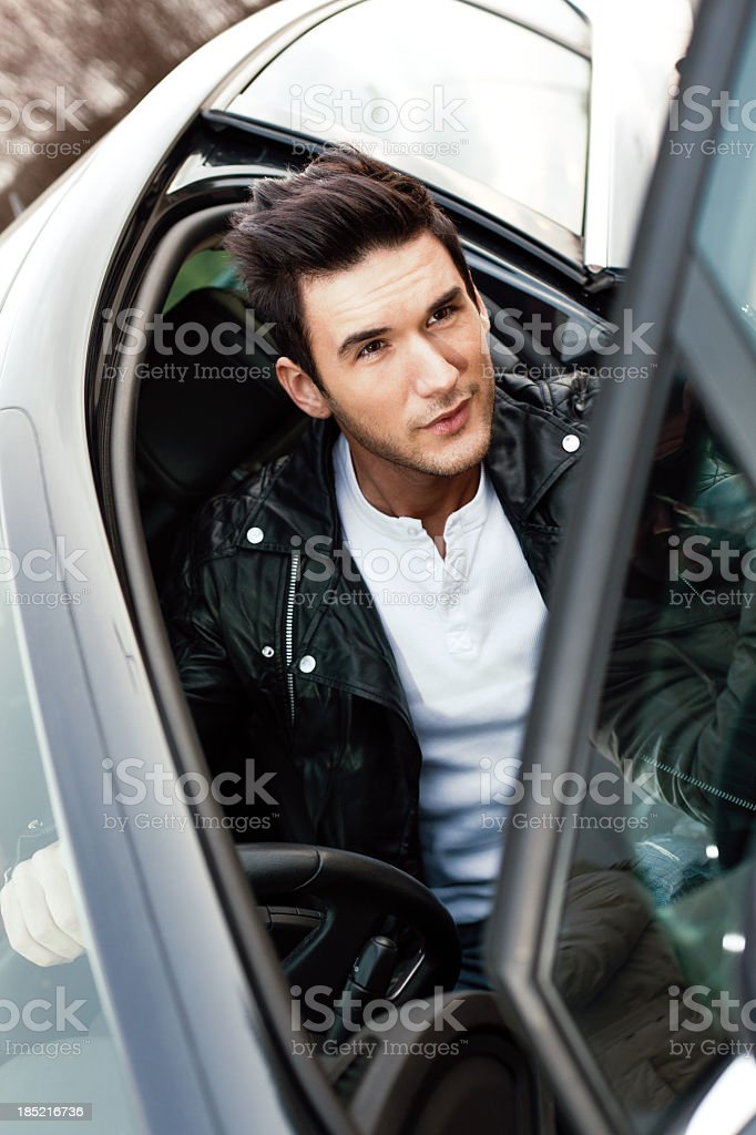 Man getting out from the car stock photo