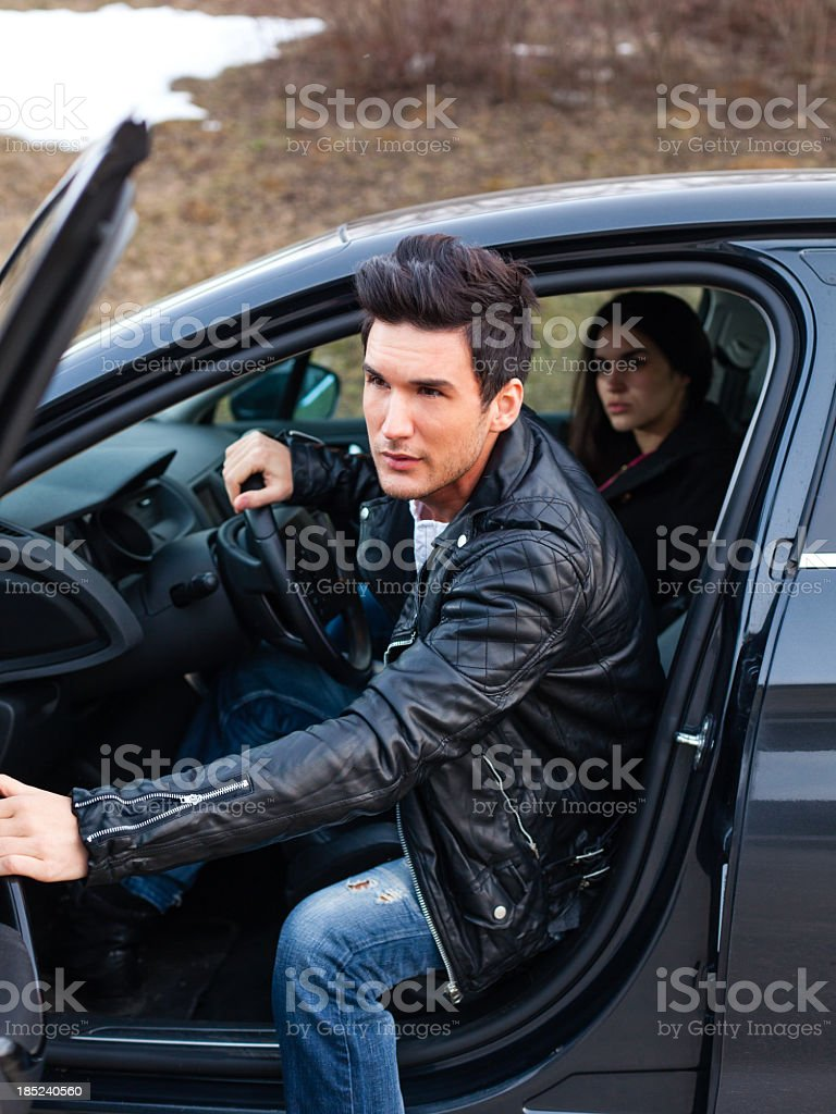 Man getting out from the car royalty-free stock photo
