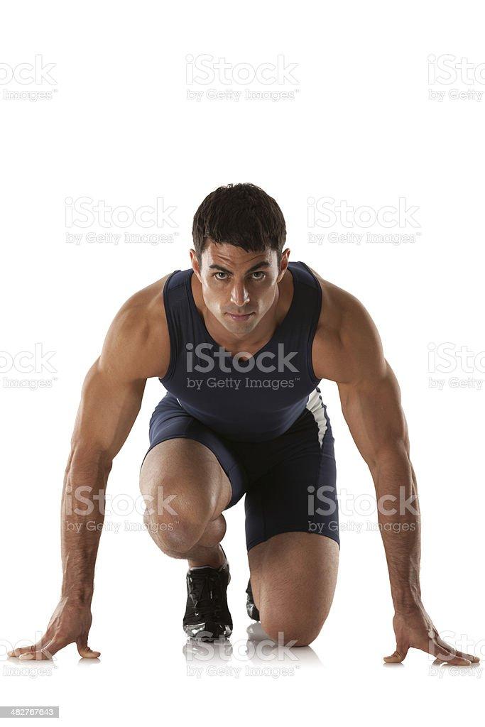 Man getting ready to run royalty-free stock photo