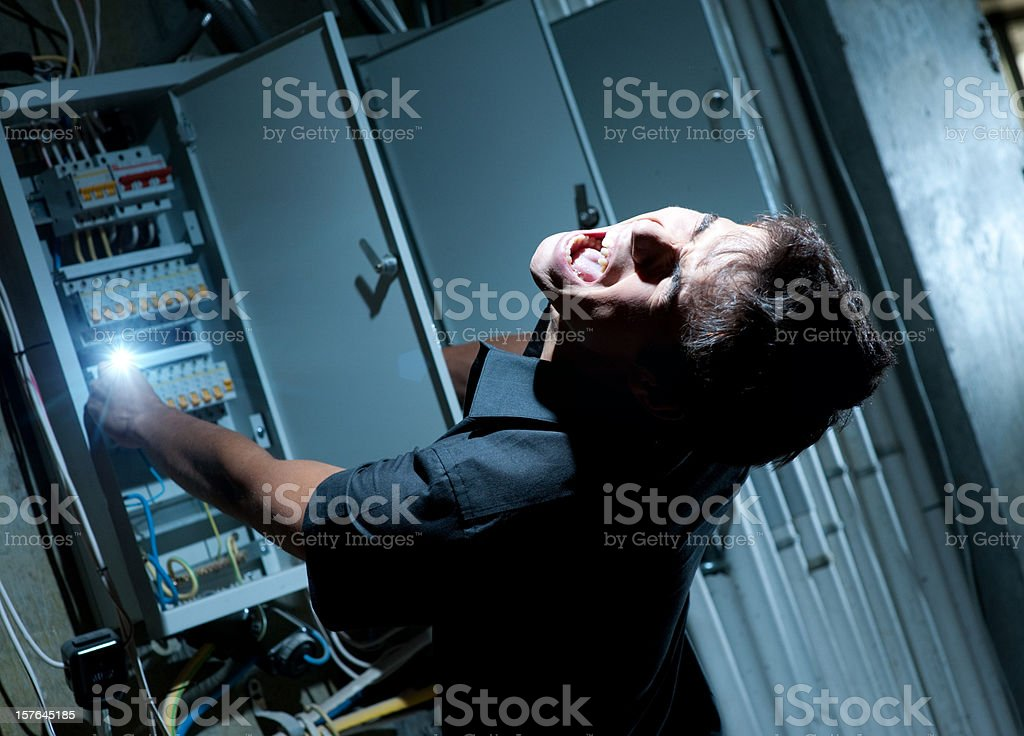 Man getting shocked by electricity on a breaker stock photo
