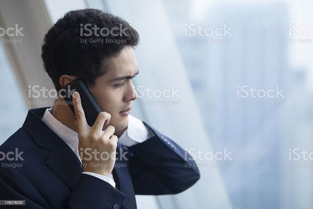 A man getting some serious news over the phone stock photo