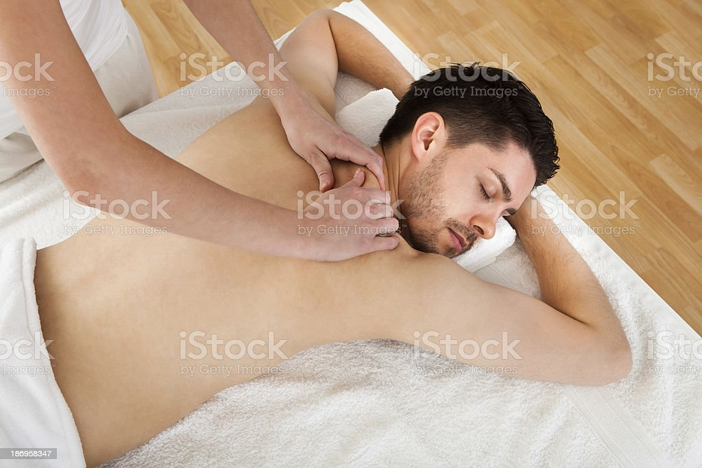 Man getting spa treatment royalty-free stock photo