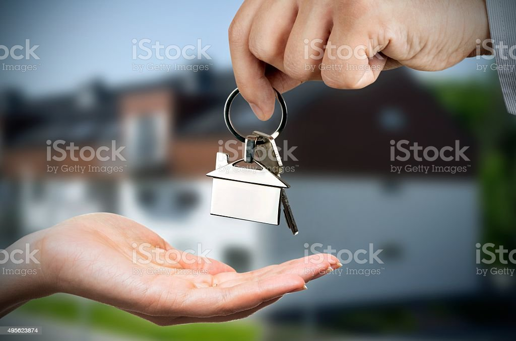 Man gives a woman the keys to a new home stock photo