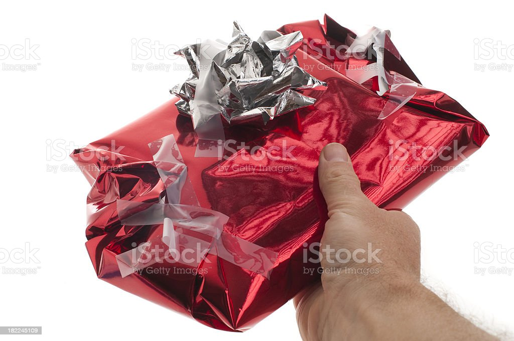 'Man gives badly wrapped, messy Christmas present' stock photo
