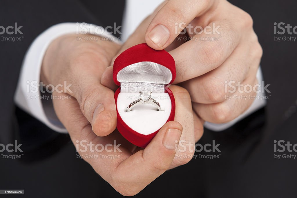 man giving a diamond ring stock photo