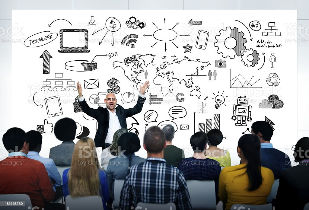 Man giving a group global business presentation stock photo