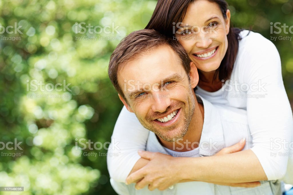 A man giving a woman a piggyback ride  royalty-free stock photo