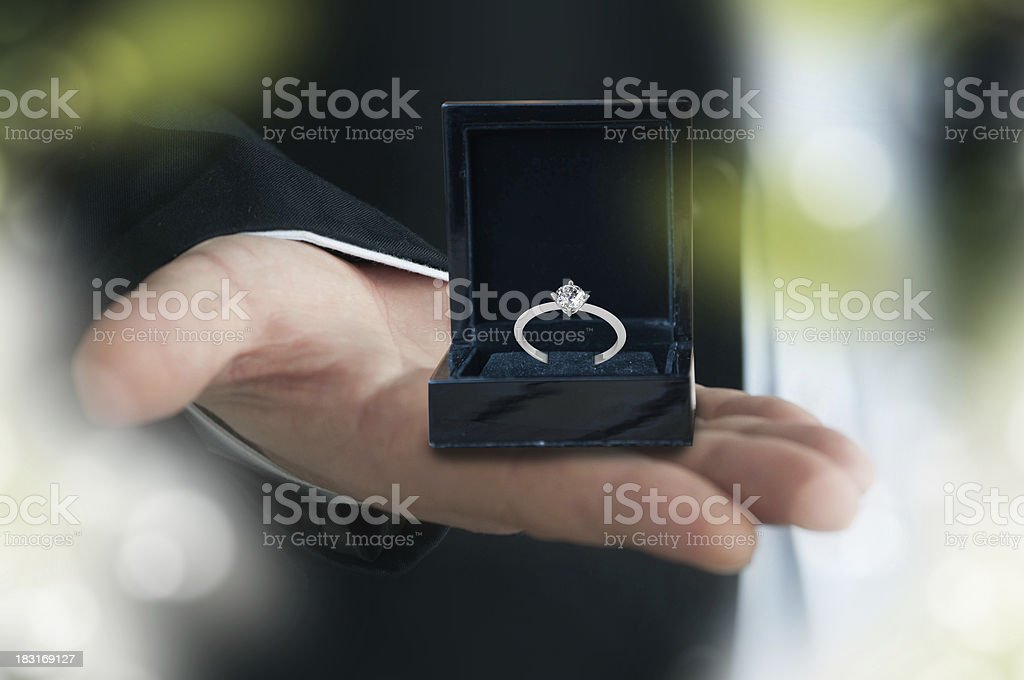 Man giving an engagement ring stock photo