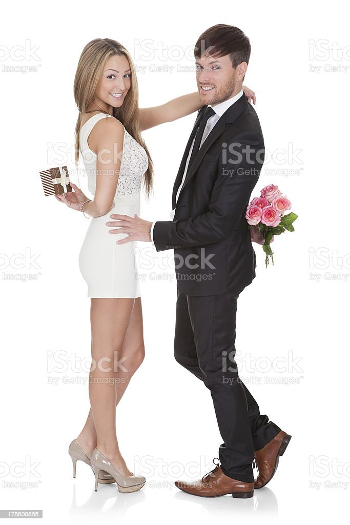 Man giving fresh flowers to woman royalty-free stock photo