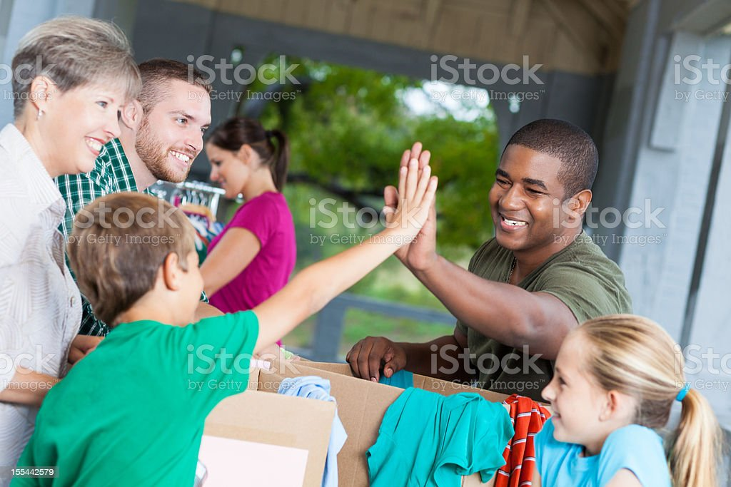 Man giving high-five at a donation center or garage sale royalty-free stock photo
