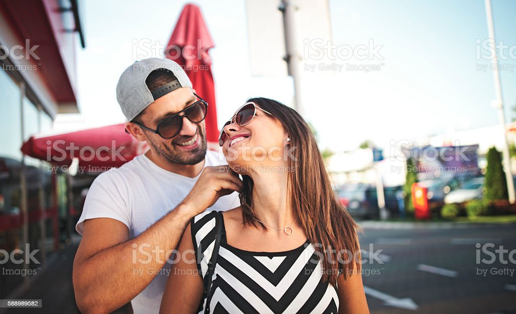 Man giving his wife a necklace as gift stock photo