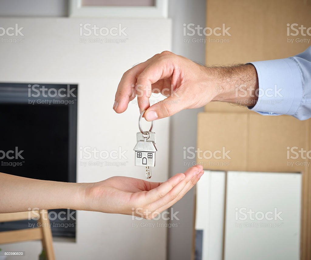 Man Giving Home Key To Woman stock photo