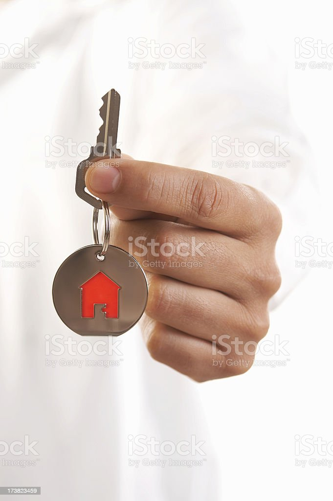 Man giving house keys royalty-free stock photo