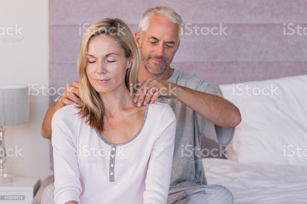 Man giving massage to his wife royalty-free stock photo
