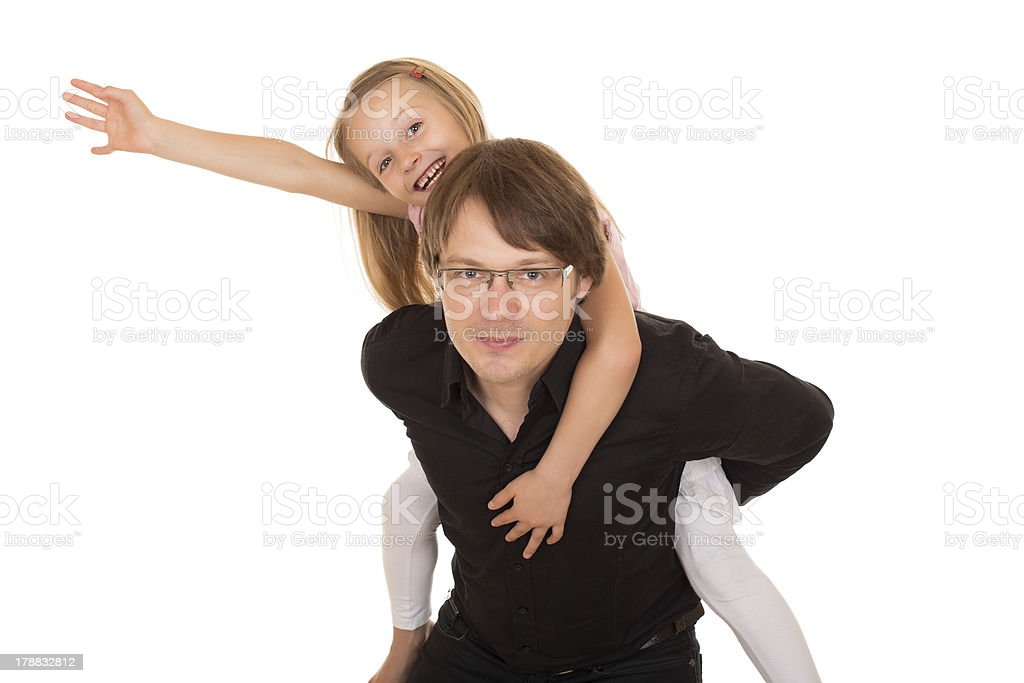 Man giving piggyback ride to a little girl royalty-free stock photo